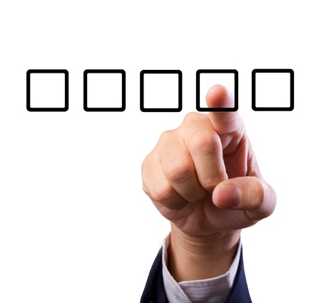 education choice: Business man hand choose check box isolated Stock Photo