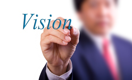 business man writing vision word