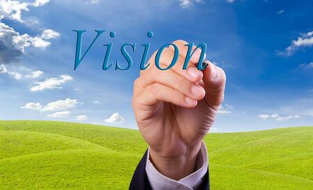 art activity: business man hand writing vision word