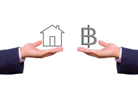 house exchange: business man hand exchange baht sign and house icon Stock Photo