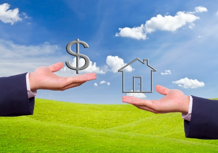 house in hand: business man hand exchange dollar sign and house icon
