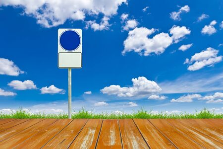 wood way and blue blank sign on blue sky photo