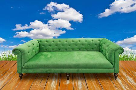 green sofa on wood floor photo