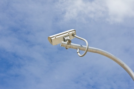 outdoor security cctv camera against blue sky photo