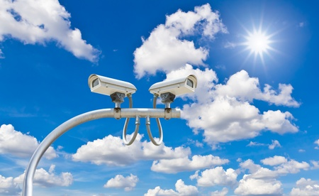 outdoor security cctv cameras against blue sky and sunshine photo