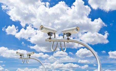 outdoor security cctv cameras against blue sky photo