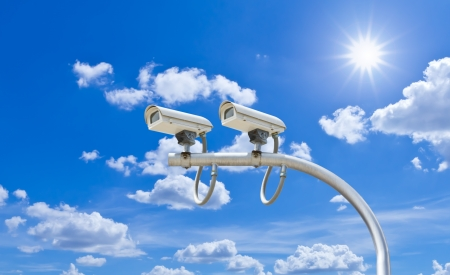 surveillance cameras against blue sky Stock fotó