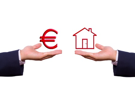 income market: hand exchange euro sign and house icon Stock Photo