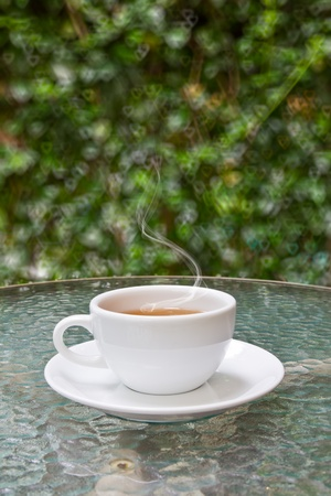 cup of tea on glass table photo