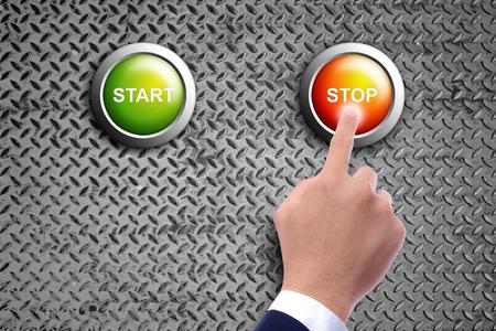hand pushing stop button on diamond steel background Stock Photo - 11201801