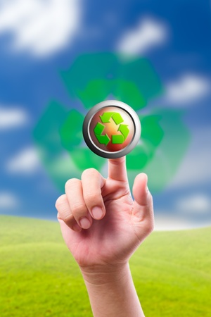 hand pushing recycle button photo