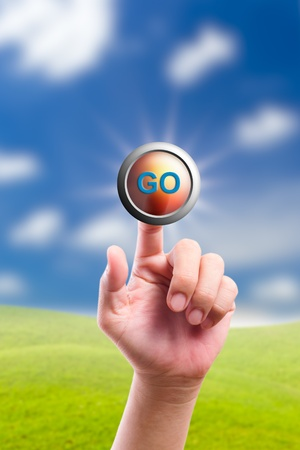 hand pushing go button Stock Photo - 11201234