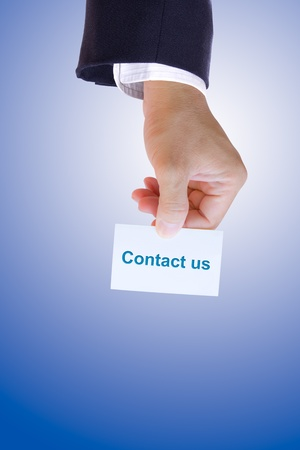 hand holding contact us card photo