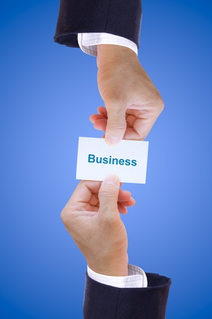 hand holding business card isolated photo