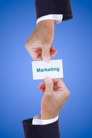 hand holding marketing card photo