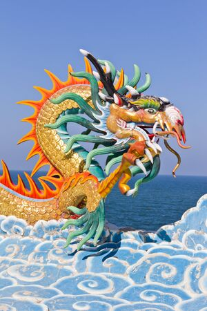japanese dragon: dragon statue against blue sky in chinese temple Stock Photo
