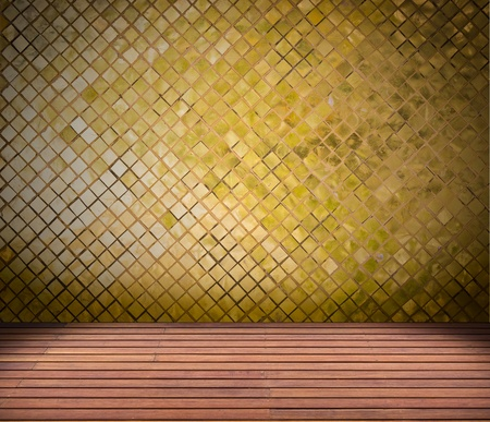 golden mosaic wall and wood floor photo