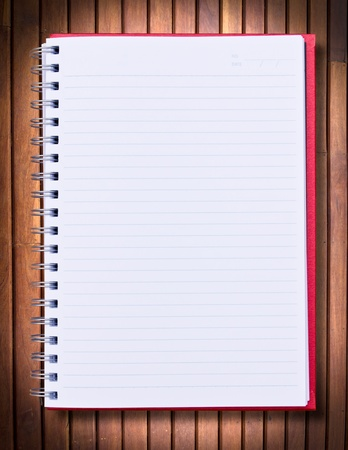 red notebook on wood background Stock Photo - 12379564