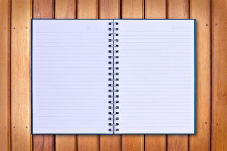 blue notebook on wood background photo