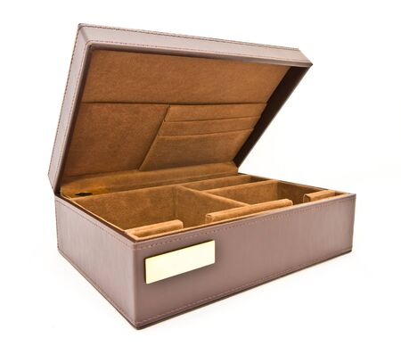 unexpectedness: brown leather box on white background Stock Photo