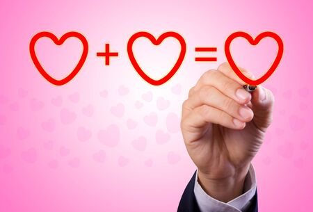 hand writing love mathematical equation  of heart photo