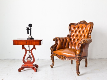 antique chair: vintage luxury armchair and telephone in white room