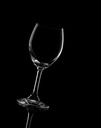 wine glass on black background photo