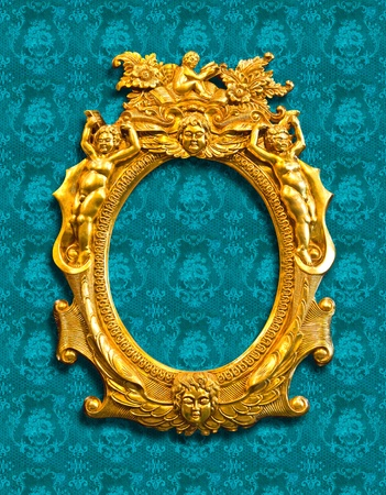 golden sculpture frame on fabric texture with clipping path photo
