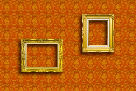 frame of golden wood  on yellow wallpaper photo