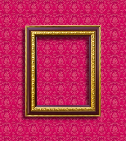 frame of golden wood  on pink wallpaper photo