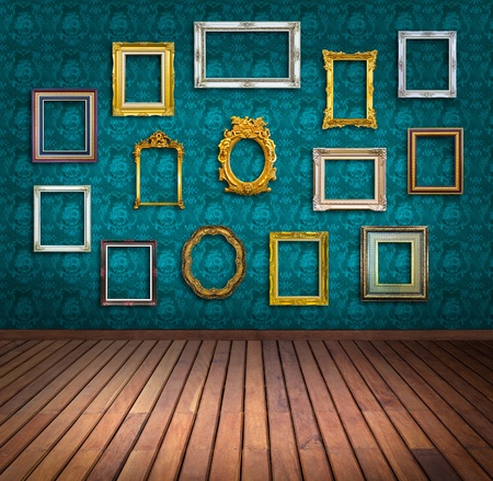 exhibitions: vintage frame in blue wallpaper room Stock Photo