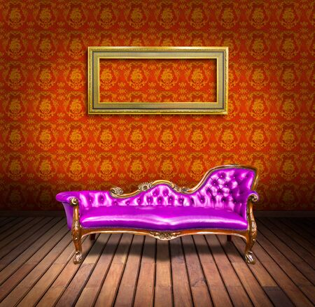 vintage luxury armchair and frame in orange wallpaper room photo