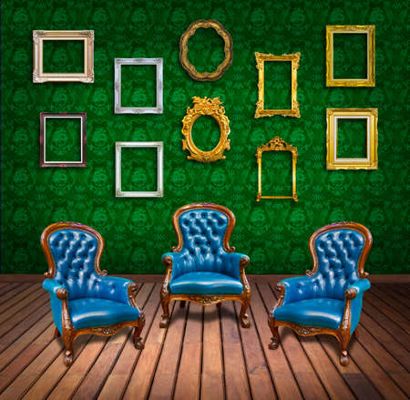 vintage luxury armchair and frame in green wallpaper room photo