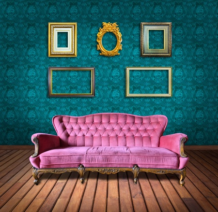 vintage luxury armchair and frame in green wallpaper room