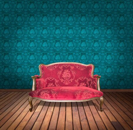vintage red luxury armchair and in blue wallpaper room photo