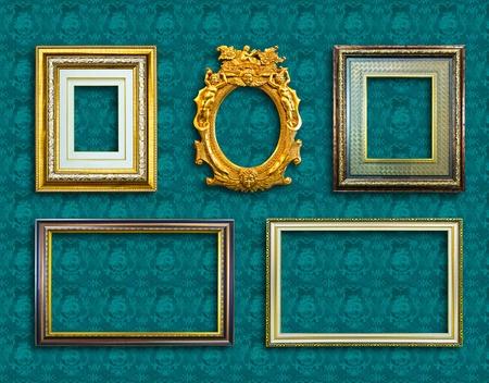 frame of golden wood  on blue wallpaper photo