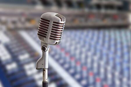 sound mixer: vintage microphone on sound mixer background