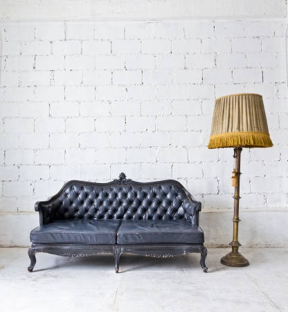 old sofa: vintage luxury armchair in white room