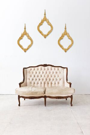 vintage frame and sofa in white room photo