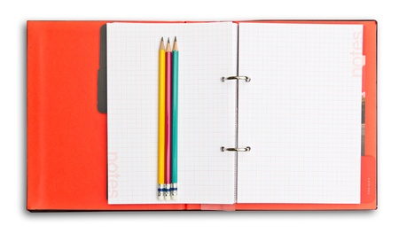 red notebook and pencil isolated photo