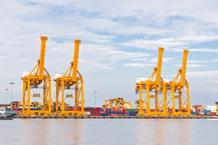 container port: crane working with container cargo in shipyard