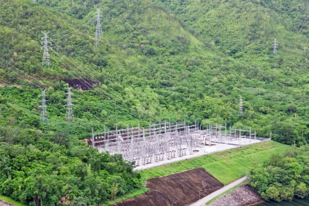 power distribution: high voltage power plant on the mountain