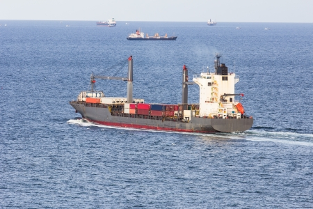 cargo ship sailing on the sea photo