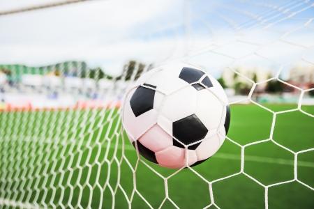 voetbal in het doelnet Stockfoto