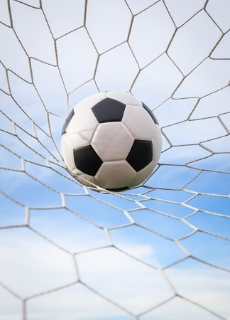 football in the goal net photo