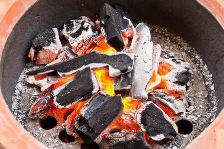coal fire: fired coals in the stove