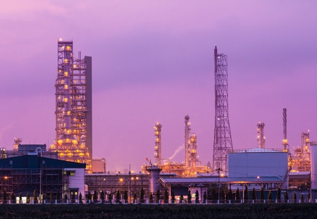 oil refinery plant and smoke at twilight morning photo