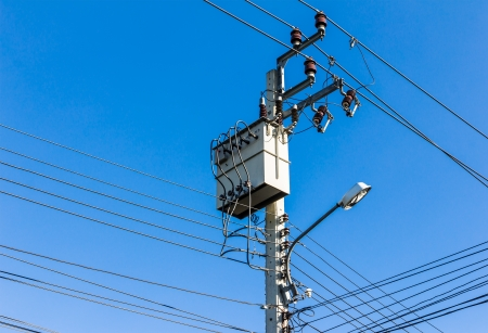 electricity high voltage transformer against blue sky Stock Photo - 17680031
