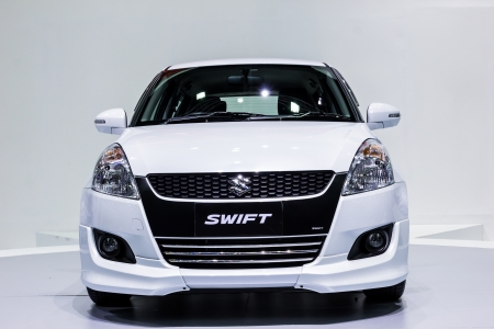 car front: BANGKOK-DEC 03: Suzuki Swift on Display at Thailand International Motor Expo 2012 ,December 03 in Bangkok, Thailand Editorial