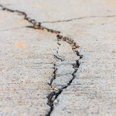 cracked concrete: close up of crack cement road